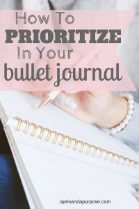How to prioritize in your bullet journal. Woman writing in a notebook.