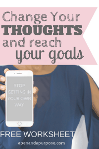 woman holding phone that says stop getting in your own way. Change your thoughts and reach your goals.