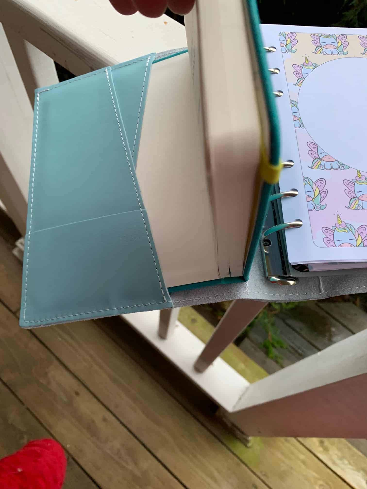 Placing hard bound notebook into foxy fix ring binder.