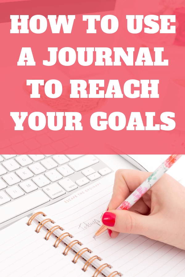 Woman writing in her journal. How to use a journal to reach your goals.
