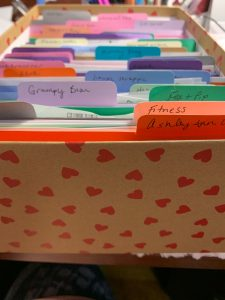 Organizing stickers in a photo box using small folders I cut with a Silhouette Cameo